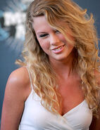 Taylor-swift smile look down white dress