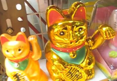 Gold cat and side cat waving to you