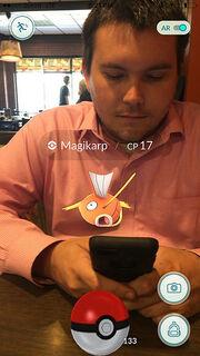 Corey with a magikarp at Sabrina's Cafe
