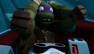 Donatello Shocked At Seeing Fugitoid's Decapitated Head On His Lap