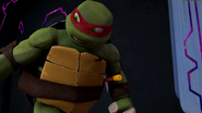 Raph pushing Donnie away