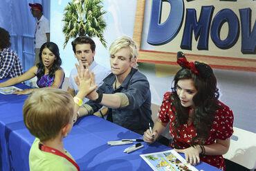 Ross high fiving a fan at D23