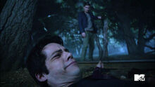 Pete-Ploszek-Dylan-O'Brien-Garrett-Douglas-whips-Stiles-Teen-Wolf-Season-6-Episode-10-Riders-on-the-Storm