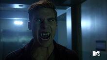 Pete-Ploszek-Garrett-Douglas-green-eyes-fangs-Teen-Wolf-Season-6-Episode-10-Riders-on-the-Storm
