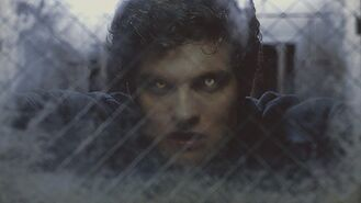 Isaac in holding cell