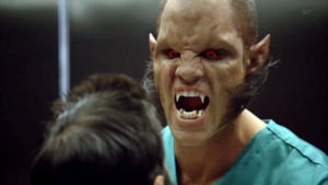 640px-Teen Wolf Season 3 Episode 1 Tattoo Brian Patrick Wade Alpha Ennis Elevator Fight