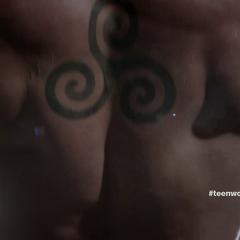 Derek's triple spiral tattoo.