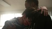 Dylan-Sprayberry-Khylin-Rhambo-Mason-holding-Liam-Teen-Wolf-Season-6-Episode-14-Face-to-Faceless