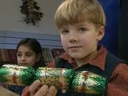 Sam holding a Christmas cracker