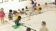 The children painting with their hands and feet