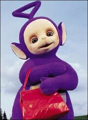 Tinky Winky Is Known For Holding A Red Handbag