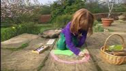 Emma create pavement drawings with chalk