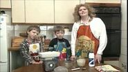 George, Thomas and her mum making bread