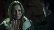 Kara and Josh touching hands through a hologram