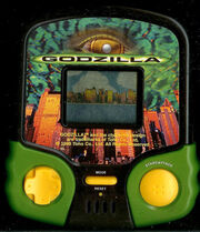 MGA GODZILLA ELECTRONIC HANDHELD TRAVEL ARCADE MOVIE PORTABLE TOY LCD GAME
