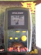 MGA GODZILLA VIRTUAL SHAKIN' Hand-Held LCD game MOSC NEW 1998 movie version0