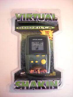 MGA GODZILLA VIRTUAL SHAKIN' Hand-Held LCD game MOSC NEW 1998 movie version