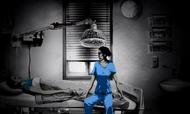 Liz sitting in Susan's hospital room