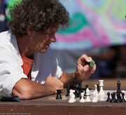 Male Chess Player contemplating a move, in the Centennial Park on the Embarcadero at Morro Bay Blvd., Morro Bay, CA.