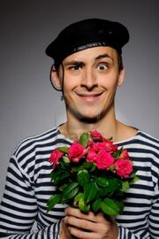 7887006-funny-emotional-romantic-sailor-man-holding-rose-flowers-prepared-for-a-date