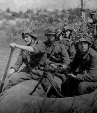 800px-Spanish soldiers on a raft during the Eastern Front scenario of World War II