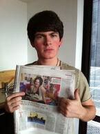 Brad holding Newspaper