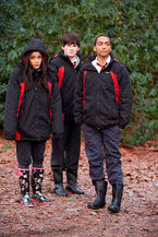 -Lewis-And-Mara-Jaffray-Tasie-Lawrence-Standing-In-The-Woods-Wearing-Crew-Jackets-House-Of-Anubis-The-Touchstone-Of-Ra-Nickelodeon-UK-Facebook-HoA-SIBUNA