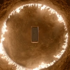 A circle of flame around the coffin