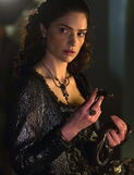 Mary holding a snake S1