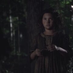 a young Tituba in the woods