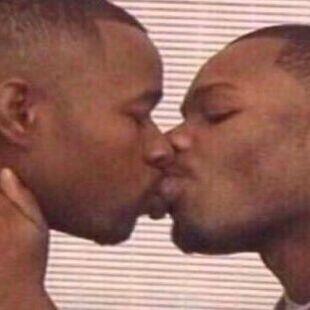 2 black guys kissing