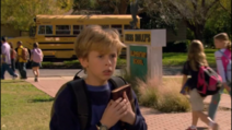Max holding his journal protectively