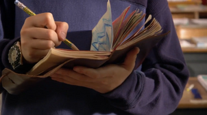 Max writing in his journal