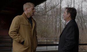 S01E09-Stan Frank under bridge