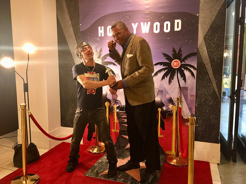 Actors Danny Belrose and Darryl Maximilian Robinson have a mock fight over Fake Oscars at Sweet at The Hollywood & Highland Center.