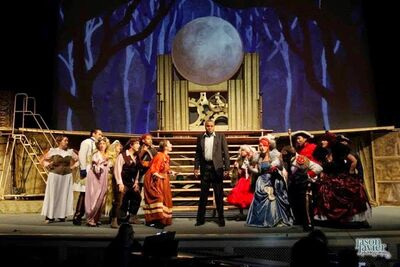 Darryl Maximilian Robinson as The Narrator and The Mysterious Man ( Center ) Joined by The Entire Cast of The Burbank Community Theatre Into The Woods (1)