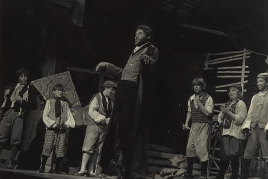 1981 Fort Wayne News-Sentinel Award Winner Darryl Maximilian Robinson as Fagin ( center ) with the cast of The Enchanted Hills Playhouse production of Lionel Bart's OLIVER!