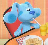 Blue is drinking milk