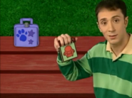 Steve pulling out his Notebook and it's the same shape as the lunchbox (Second Clue)