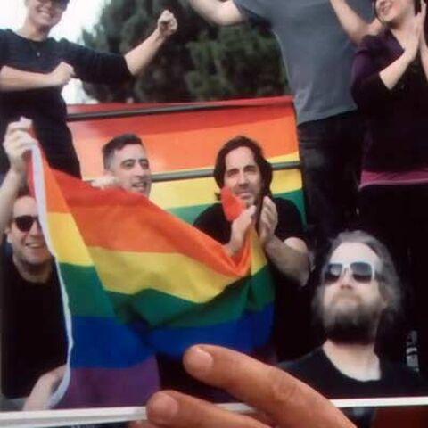 Fabrice and Ridge in the pride parade in Paris.