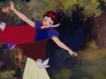 Forest animals pulling Snow White's cape