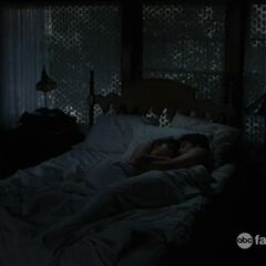 Callie and Brandon in bed together.
