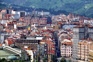23337860-Aerial-view-of-Bilbao-Spain-city-downtown-with-Mountain-Stock-Photo
