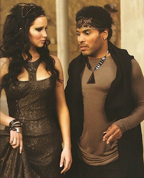 Cinna instructs Katniss on her tribute parade costume.  sc 1 st  Cinna | The Hunger Games Wiki | FANDOM powered by Wikia & Cinna | The Hunger Games Wiki | FANDOM powered by Wikia