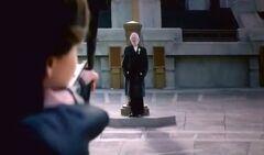 Katniss apuntando hacia el Presidente Snow