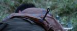 Tributo masculino del Distrito 9 con cuchillo en la espalda