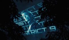 Proyección en el cielo del tributo masculino del Distrito 9