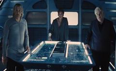 Haymitch, Finnick y Plutarch en el aerodeslizador