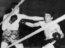 Ronnie (right), boxing as a young man.