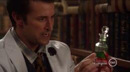 Flynn holding Bathsheba's Oil of Healing